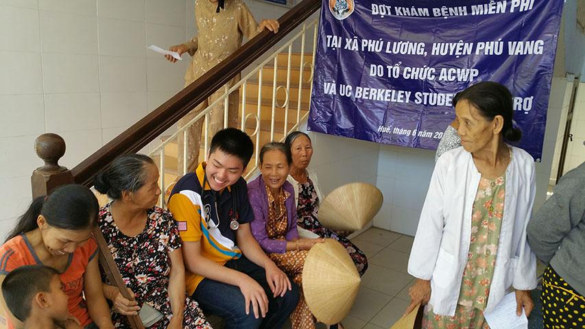 Cuong Luu conversing with elders at VMO clinic in Hue.