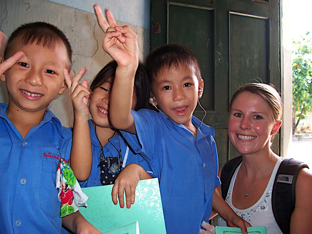 Child holding a peace sign at VMO clinic