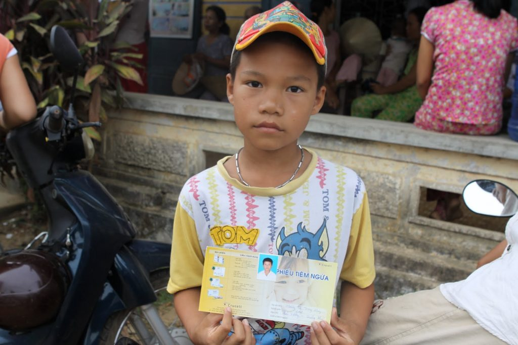 Child with vaccination record card.